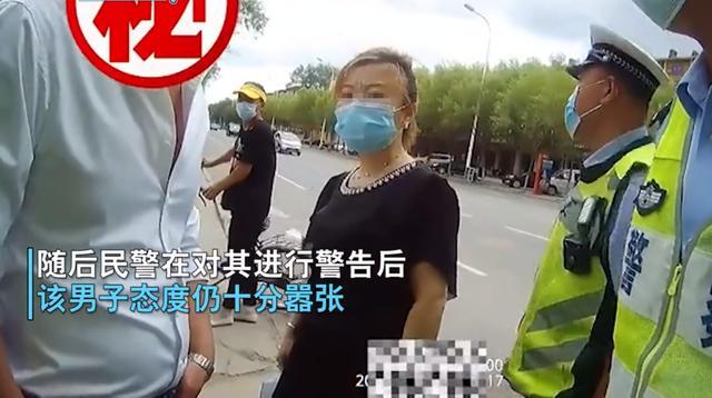 """辽宁一外子违章诅咒交警被拘,同走女子称""""给你找人"""",现被依法走拘"""